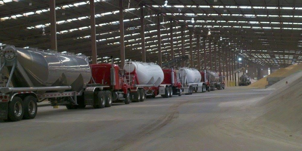 Frac sand trucks at a terminal ( Photo: Sierra Frac Sand ).