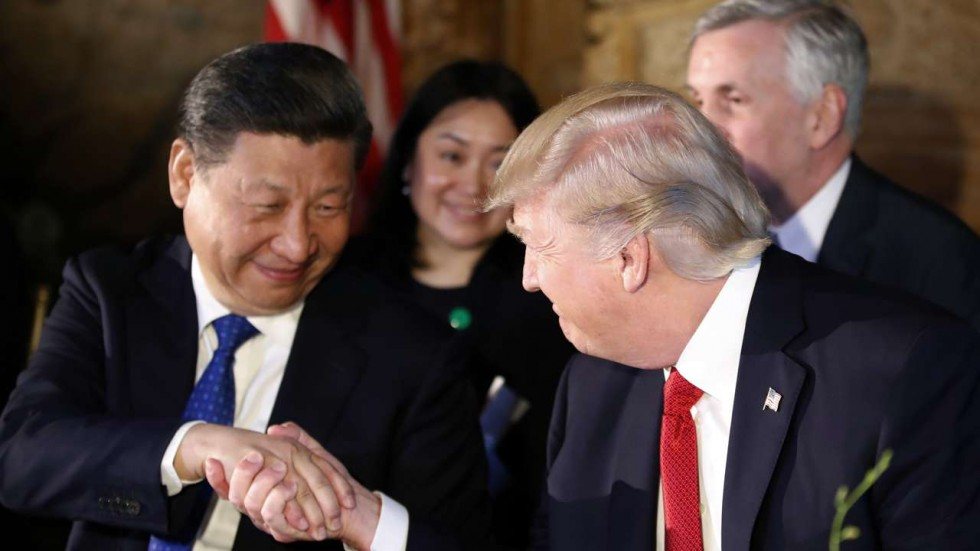 President Donald Trump and Chinese President Xi Jinping shake hands in a symbol of the partnership between the countries
