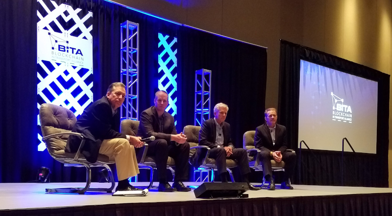 From left, George Abernathy, chief revenue officer of FreightWaves; Dale Chrystie, vice president of strategic planning & support for FedEx Freight; Craig Harper, COO of J.B. Hunt; and Ron Piwetz, enterprise architect for BNSF, listen to a question during a panel discussion during the BiTA Spring Symposium on Monday.