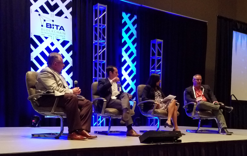 Panelists listen to Tim Leonard, senior vice president and general manager of TMW Systems, speak during a panel discussion at the BiTA Spring Symposium on Monday. Others on the panel were, from left, Dean Croke, chief analytics officer, FreightWaves; Jason Duboe, SVP of business development, project44; and Priya Rajagopalan, chief product officer for Four Kites.
