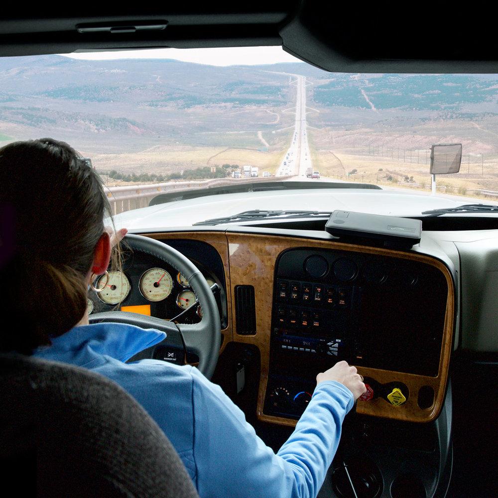 Vnomics-02-Female-Driver-in-Truck-Cab-Crop.jpg