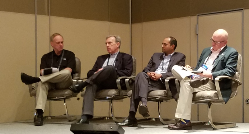 Panelists during a financial session listen as John Larkin, managing director at Stifel (second from left), speaks. Also on the panel, held at Transparency18, was Ravi Shanker of Morgan Stanley (to the right of Larkin) and Donald Broughton (right) of Broughton Capital. It was moderated by John Kingston, executive editor of FreightWaves.