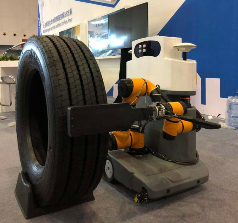 ARIS is a robotic vehicle inspector. It is currently in trail with Michelin, checking tires on commercial buses.