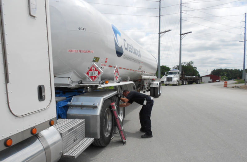 An inspector looks over a vehicle in Ohio during a inspection blitz. ( Photo: Public Utilities Commission of Ohio )