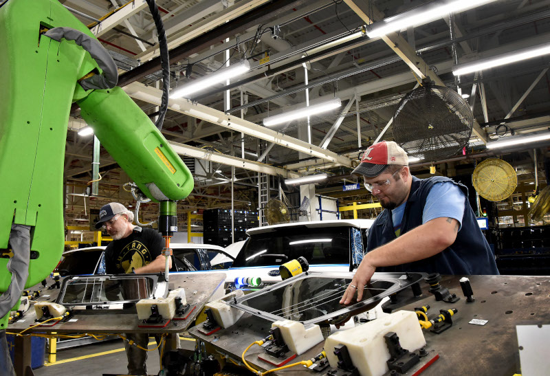 A worker builds a Ford pickup at the company's Kentucky Truck Plant.