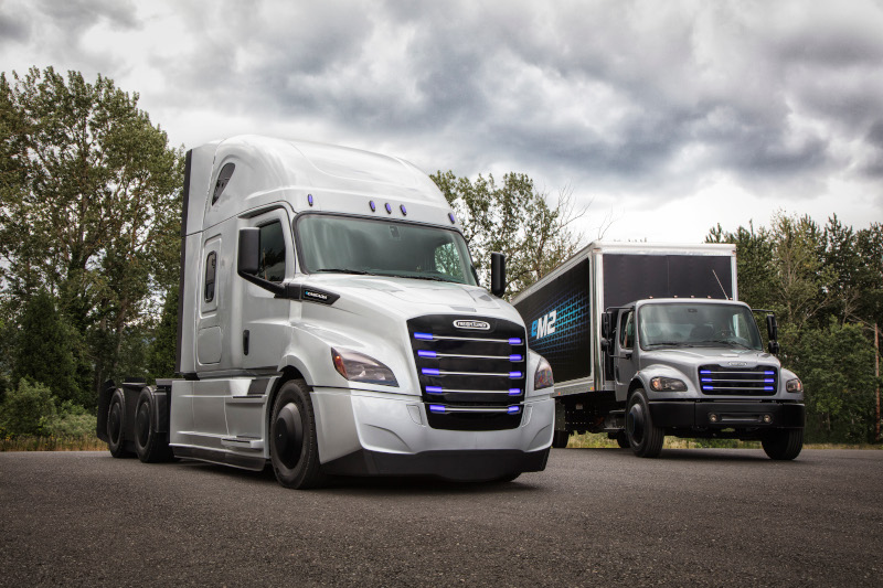 Penske and NFI will test DTNA's eCascadia (left) and eM2 electric truck models.