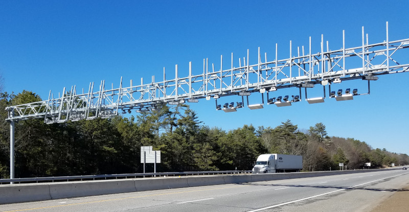 A truck passes underneath one of two currently operational toll gantries in Rhode Island along I-95. The state plans to add up to 14 total gantries to collect tolls on trucks.
