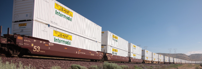 J.B. Hunt's largest segment is intermodal freight (i.e. moving freight on rail, truck, and ship- all on containerized boxes)
