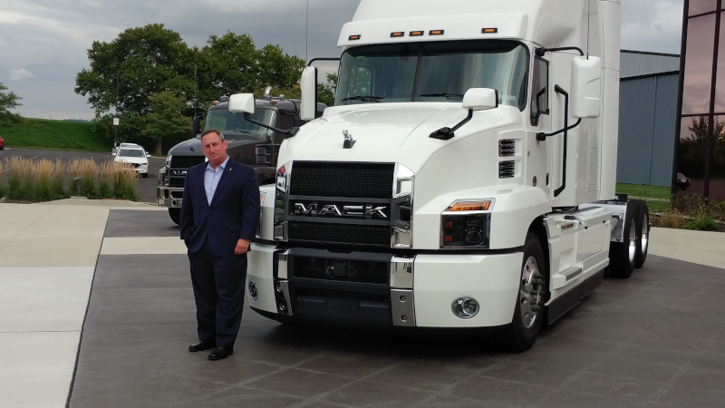 Mack Trucks President Martin Weissburg stands in front of a Mack Anthem model on Monday at the company's Customer Center in Allentown, PA.