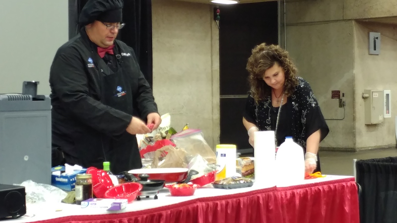 Tom Kryk a truck driver who likes to cook in his cab, gives a cooking demonstration at GATS on Thursday.