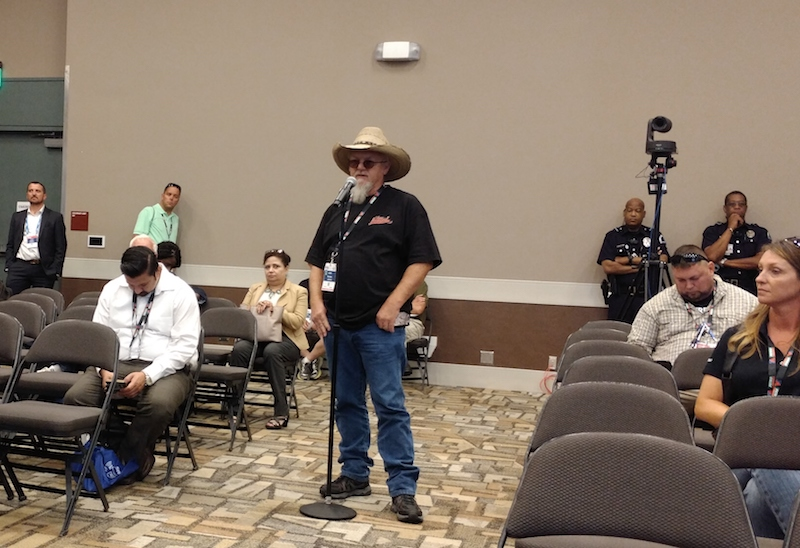 John Schmitz, an owner-operator who runs oversized equipment, speaks during the FMCSA's Listening Session on hours of service at the Great American Trucking Show on Friday.