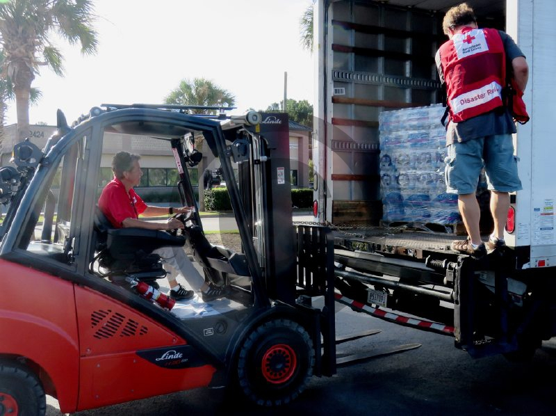Volunteers for the American Red Cross unload a truck of water ahead of the arrival of Hurricane Florence. The Red Cross and other agencies will be tasked with helping get relief supplies to those in need.  (Photo: American Red Cross)