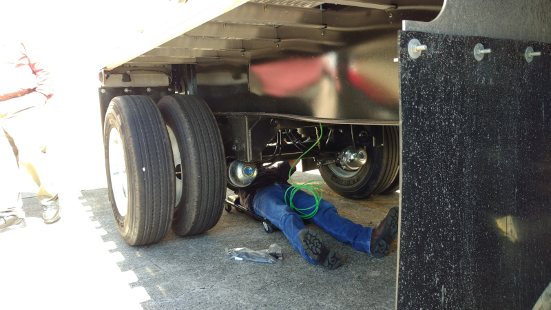 An employee from Velociti works to retrofit the P.S.I. automatic tire inflation system onto a trailer during a demonstration at P.S.I.'s San Antonio location on Oct. 10. The system can be installed on any trailer in under 4 hours.