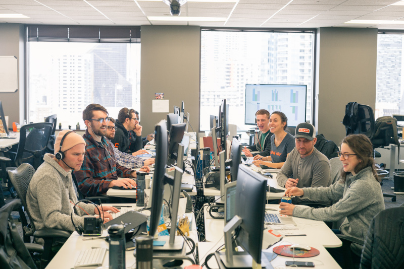Convoy employees at work in the company's Seattle office. A second location in Atlanta will be open early next year and CEO Dan Lewis is hoping the work environment in Seattle carries over to the Atlanta location. ( Photo: Convo y)