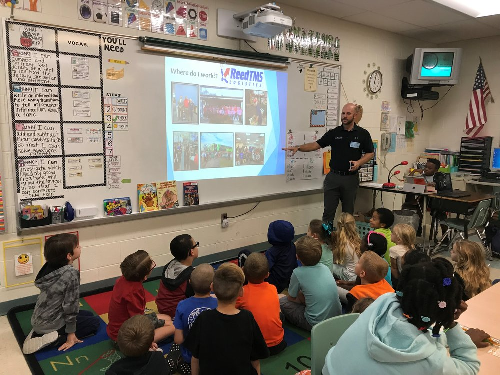 Cody Thacker teaching first graders about logistics. Photo: ReedTMS