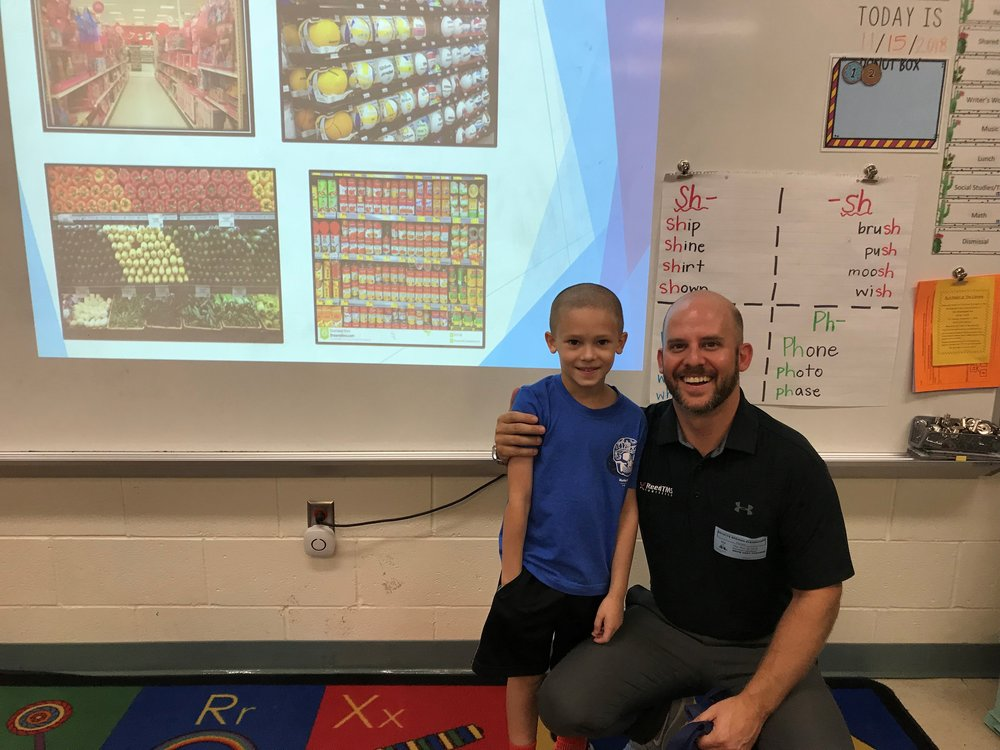 Cody Thacker and his son Greyson, who attended his father's presentation on logistics.