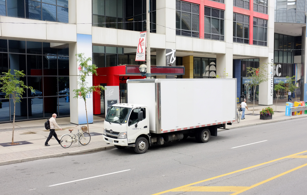 With no designated spots to park in cities like New York, delivery trucks are often stopped in travel lanes, worsening congestion. ( Photo: Shutterstock )