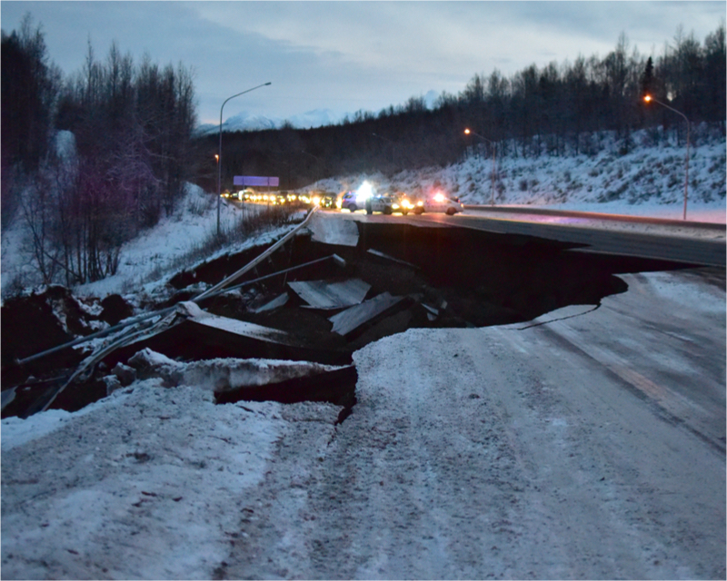 Police block traffic on the southbound Glenn Highway north of Anchorage, Alaska, due to damage from a magnitude 7.0 earthquake. ( Photo: Shutterstock )