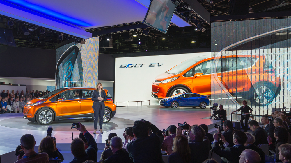 CEO Mary Barra discusses the battery-powered Bolt at a trade show in January 2015. The Bolt is one of the few smaller cars GM is sticking with.  (Photo: Shutterstock)