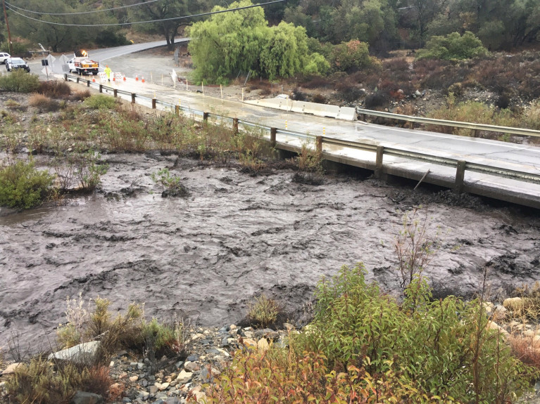 Flash flood water blackened by ash and debris from the Holy Fire rushes along Trabuco Creek  in Orange County, California on Thursday, November 29, 2018.  (Photo by Mark Rightmire, Orange County Register/SCNG)