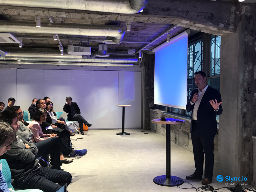 Slync CEO Chris Kirchner speaks in Tokyo. ( Photo: Slync.io )