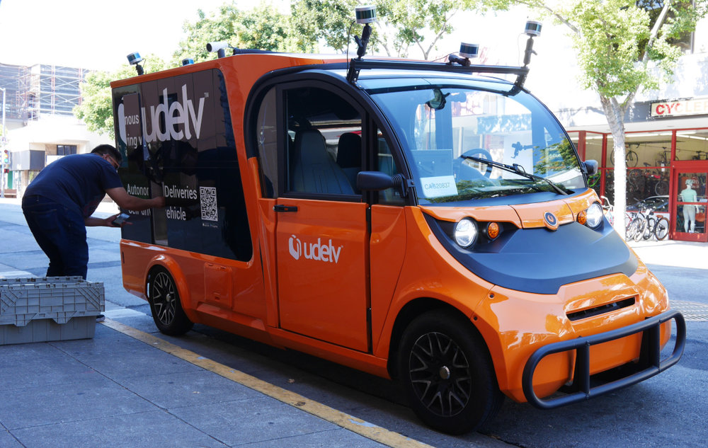 A driver unloads goods from the udelv autonomous delivery vehicle. The truck, with an electric range of about 60 miles, will enter a pilot program with XL Parts in Houston. ( Photo: Udelv )