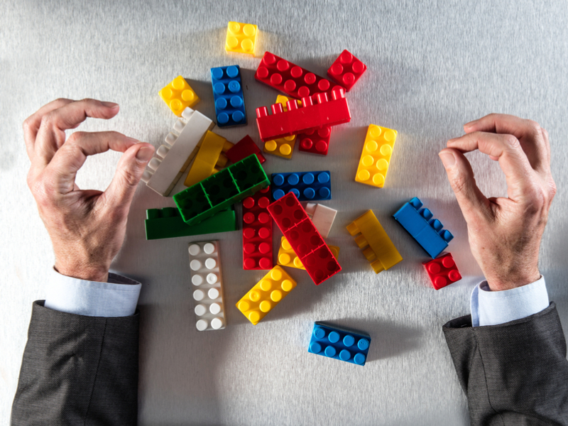 One of the Australia's top transport-planning bodies has reassigned the management of a world-leading institution to another governmental body. Australia's governance and advisory public sector can somewhat resemble the task of building a working machine using different sized, and differently shaped, multi-coloured plastic toy bricks.  (Photo: Shutterstock).