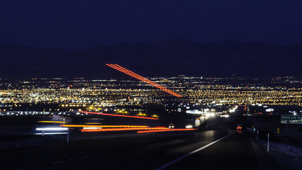 Truck vehicle miles traveled could be target of lawmakers. Above the Las Vegas landscape at night (Photo: Jim Allen/FreightWaves)