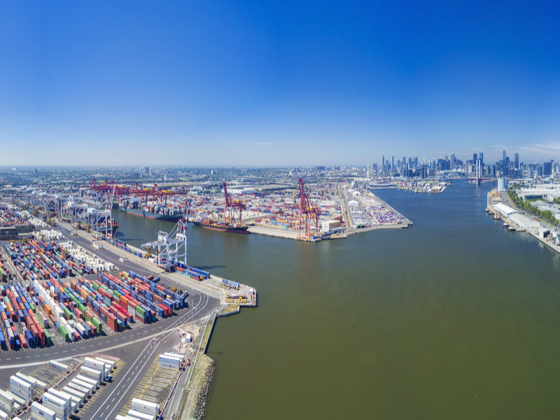 Victoria's main port is pictured in the foreground and stretches into the distance on the left-hand side of the Yarra River. The city of Melbourne can be seen in the upper right.  (Photo: Shutterstock).