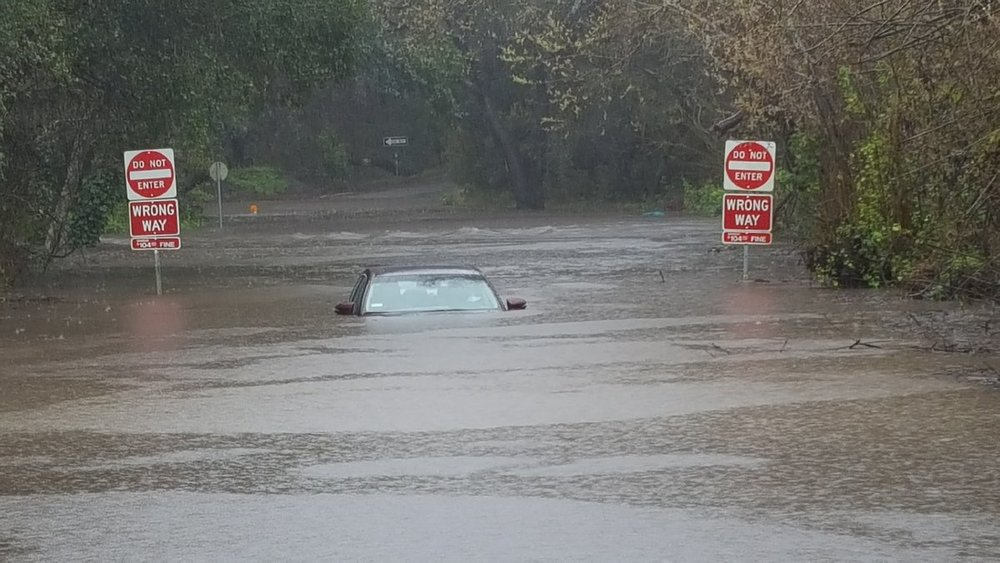 Flooding on Brookwood Drive in Santa Cruz, California on February 13, 2019. The driver was able to escape.  (Photo: California Highway Patrol, Santa Cruz)