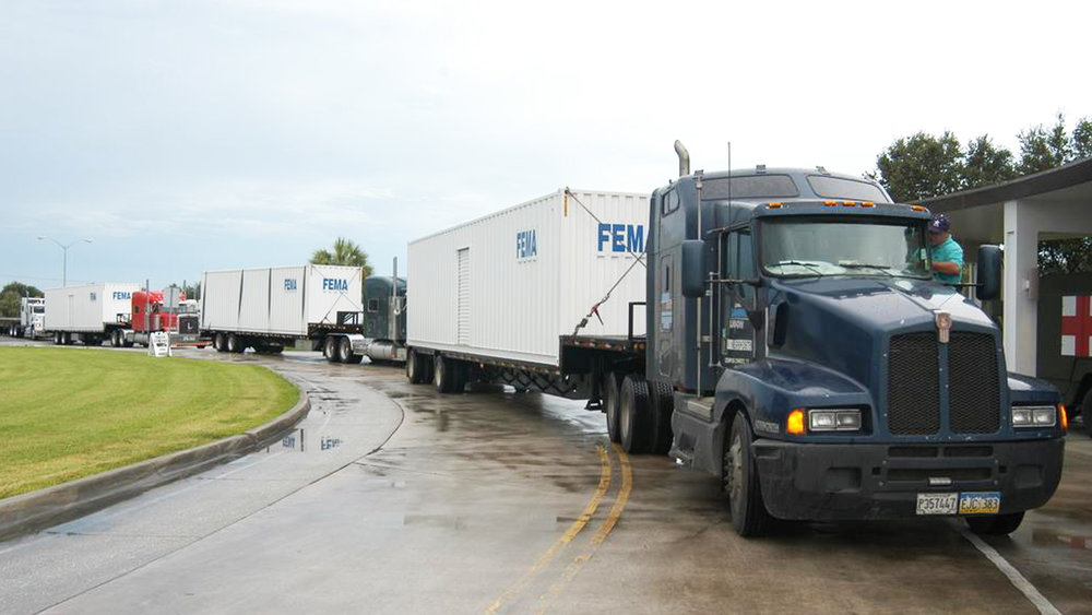 Trucks hauling FEMA containers arrive at a disaster location. Mapping disaster areas can aid in the recovery process by quickly identifying areas and items of need. ( Photo: FEMA )