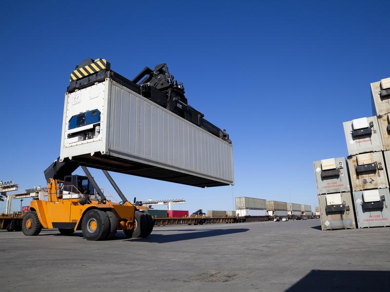 reach stacker generic container wharf waterfront - stock - shutterstock_72743287.jpg