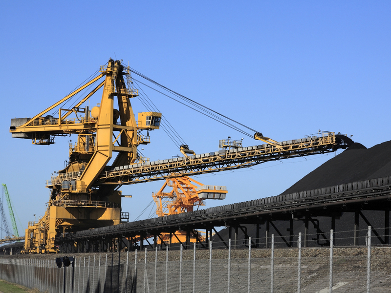 Pictured: coal loaders and stockpiles at Newcastle, Australia.  Photo: Shutterstock.
