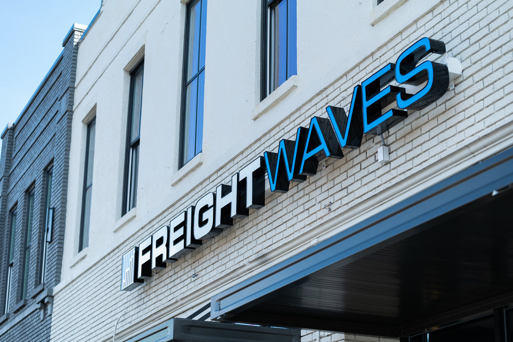 freightwaves logo on its new headquarters building in downtown chattanooga. photo credit: freightwaves/josh roden