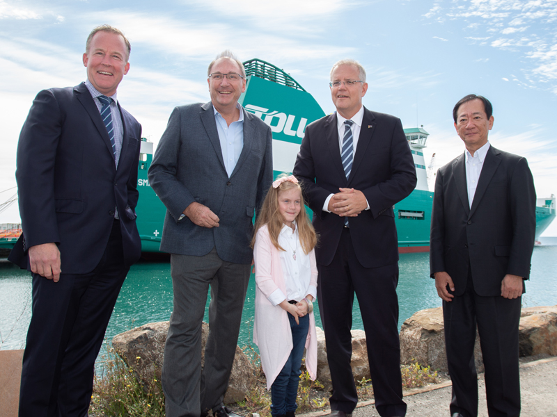 Pictured from left to right: Will Hodgman,  Premier of Tasmania ; John Mullen, Toll Group Chairman; Hayley Burr, Junior Sponsor; Scott Morrison,  Prime Minister of Australia ; Taneki Ono,  Japan Post  (which  bought Toll in 2015 ) First Executive Officer. In the background is the Tasmanian Achiever II.  Photo: Toll.