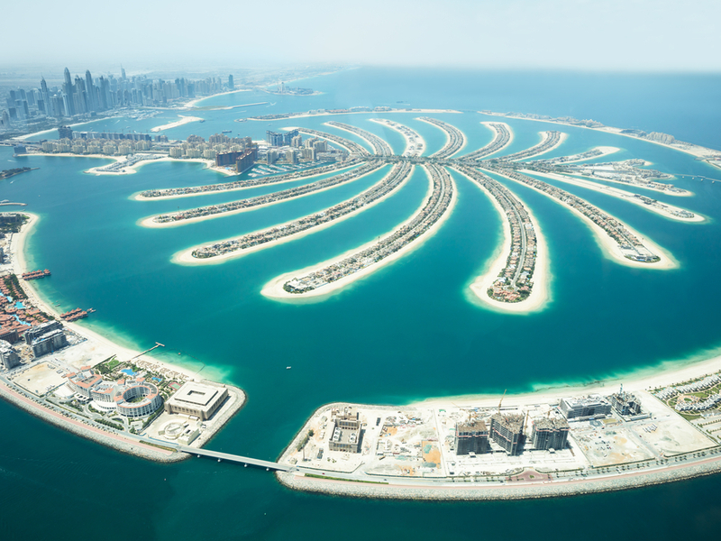 Pictured: the Palm Jumeirah, the mega-reclamation that has become a globally-recognized icon of Dubai, UAE. Global box-terminal operator DP World is based in Dubai. The city of Dubai is located to the upper left of the image.  Photo: Shutterstock.