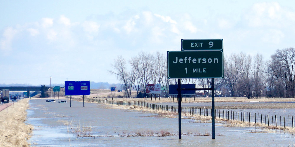 Flooding in Jefferson, South Dakota, stranded two cars along the highway. Heavy snow melt and rains have caused historic flooding in 16 states including near the MIssouri River, and the FMCSA has lifted certain restrictions as a result. (Photo: Shutterstock)