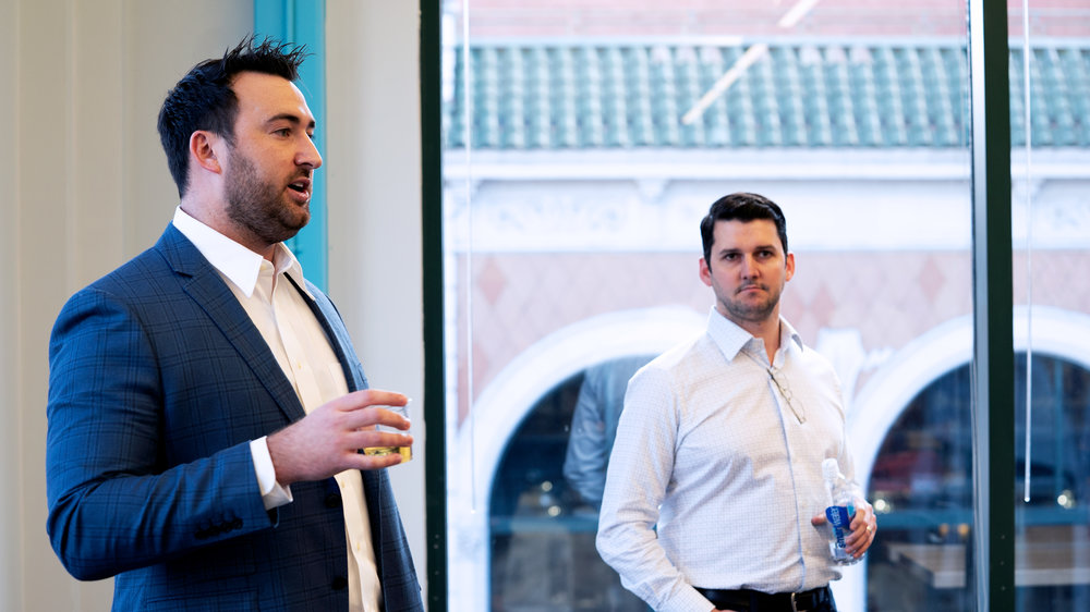 Arrive CEO Matt Pyatt, left, and President Eric Dunigan, right, celebrate the opening of the Chattanooga office in November, 2018. ( PHOTO: LEXI ALVIDREZ / FREIGHTWAVES )