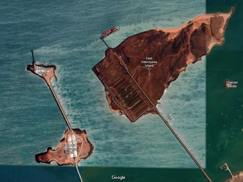 Pictured: the export facilities at Dampier. Upper right are the iron export stockpiles, to the left are the salt export stockpiles.  Photo: Google Earth.