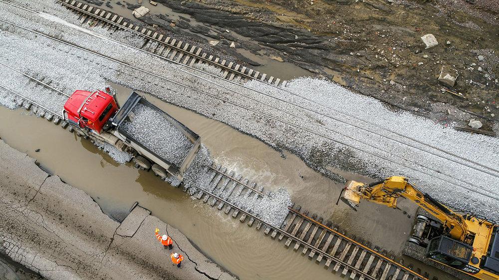 BNSF Railroad crews replenishing ballast onto tracks damaged by flooding near La Platte, Nebraska. (Photo: BNSF)