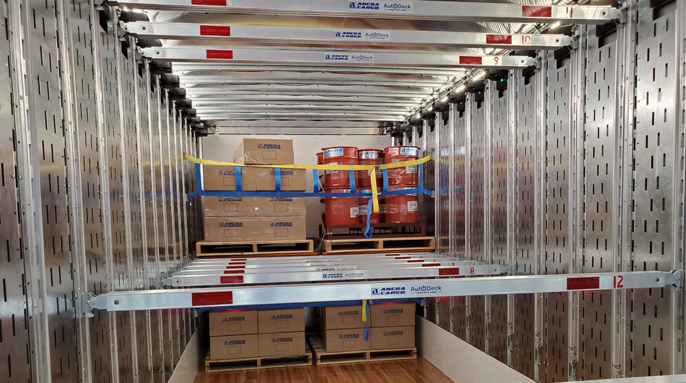 Ancra has introduced automated decking, which adjusts itself up and down the trailer based on keypad inputs from the user, eliminating the need to manually adjust support beams. ( Photo: Brian Straight/FreightWaves )