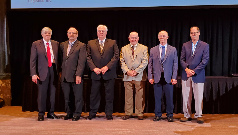The 2019 NPTC Driver Hall of Fame inductees stand on stage after being honored by NPTC at its annual conference. From left, Gary Petty, president and CEO of NPTC, Driver Hall of Famer Dana Alitz, John Deere Shared Services, assigned by CPC Logistics; Driver Hall of Famer Kenneth George, Hy-Vee; Driver Hall of Famer Joe Choplin, Unifi Manufacturing; Driver Hall of Famer Larry Johnson, Messer; and Del Lisk, vice president of safety services at Lytx, which sponsored the ceremony.