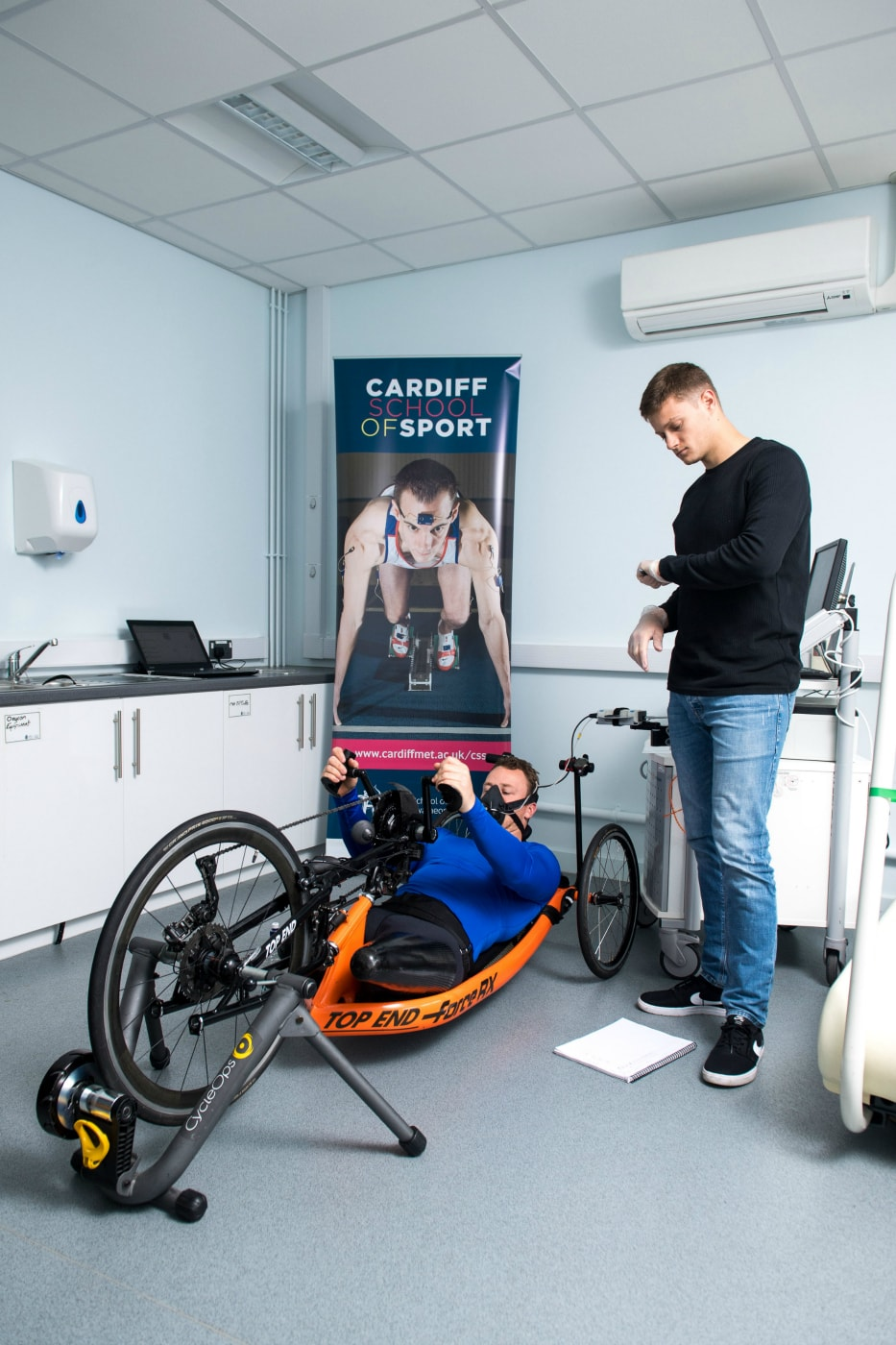 Racer Michael Swain MBE with Cardiff Met student Alex Hunt.