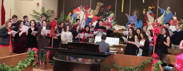 Members of the Westfield Concert Choir rehearsing before the 2017 performance