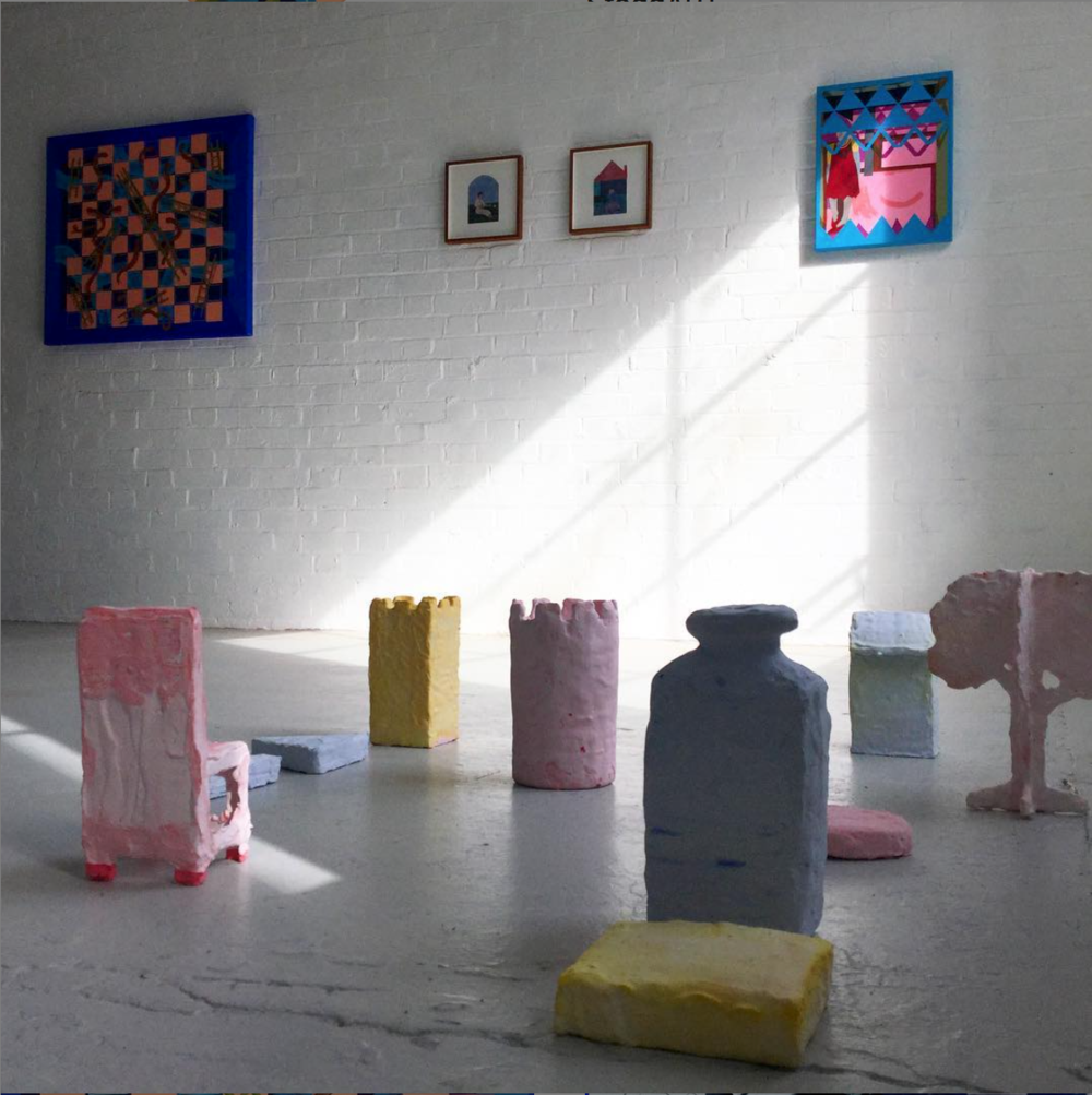 Installation shot of sculptures  Game Pieces  and paintings. (Small framed works by Bobbye Fermie)