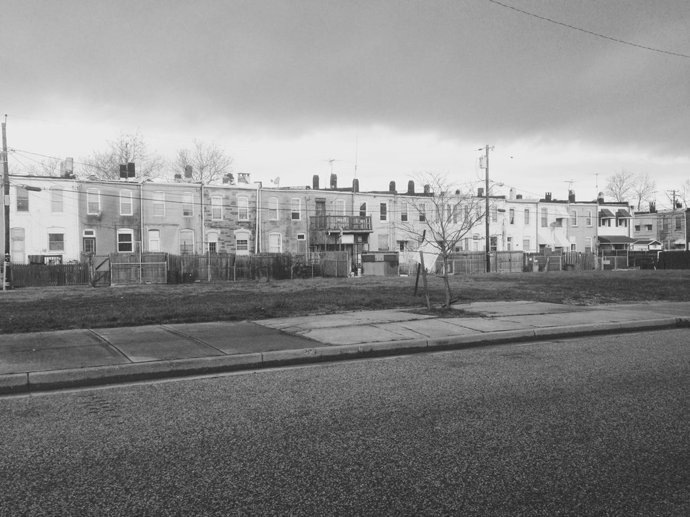 My sister, Jeanne, and I drove into south Baltimore one day in December 2016 to the neighborhood where our Dad, Bill Jr grew up. We stopped on the way near Pigtown and Jeanne took this photograph. Row houses with tidy gardens and small back yards.