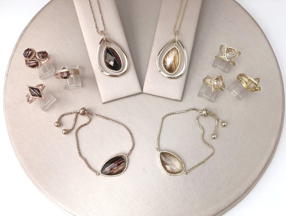 The Stardust Collection - A vibrant mix of metallic infused faceted glass stones expertly cut into unique shapes and made with impeccable quality. Set in Sterling Silver with 14K Gold, Rose Gold and rhodium platings, each piece is designed to be wearable art with exquisite detail for the woman who loves to shimmer.