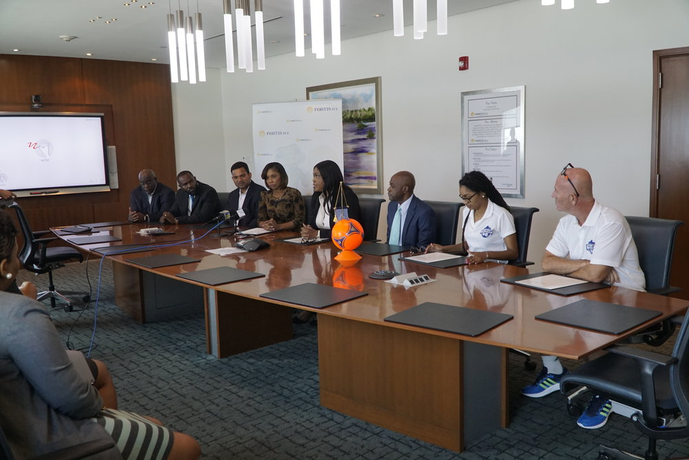 Contract Signing (L-R) Allan Robinson, Devon Cox, Nigel Hosein, Ruth Forbes, Eddinton Powell, Sonia Bien- Aime, Oliver Smith, Candia Ewing, Darren Meehan