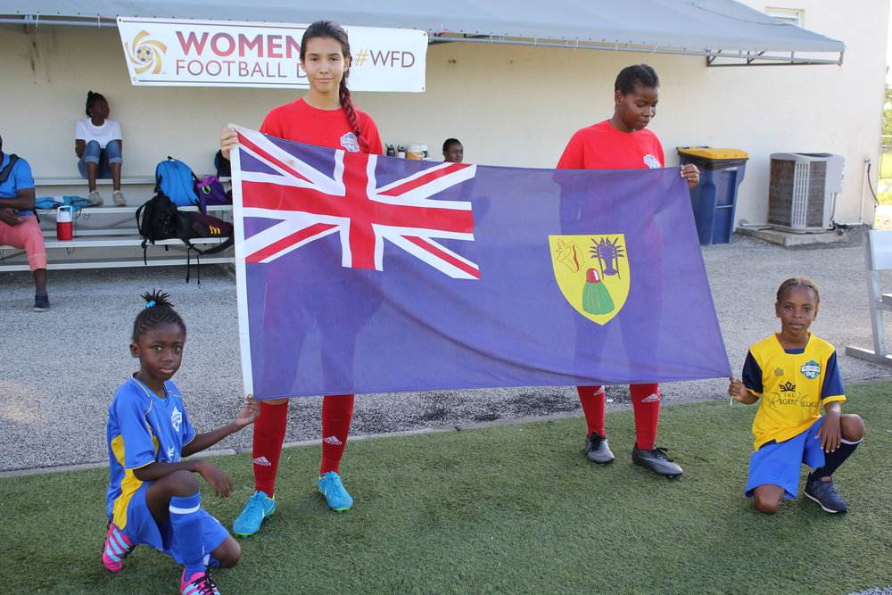 Women's National Team players and youth players holding the Turks & Caicos Islands Flag .JPG