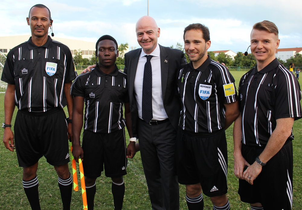 (L-R) FIFA Asst Referee Dane Ritchie, Jackson Pierre, FIFA President Gianni Infantino, FIFA Referee Gianni Ascani, and Dan Willis